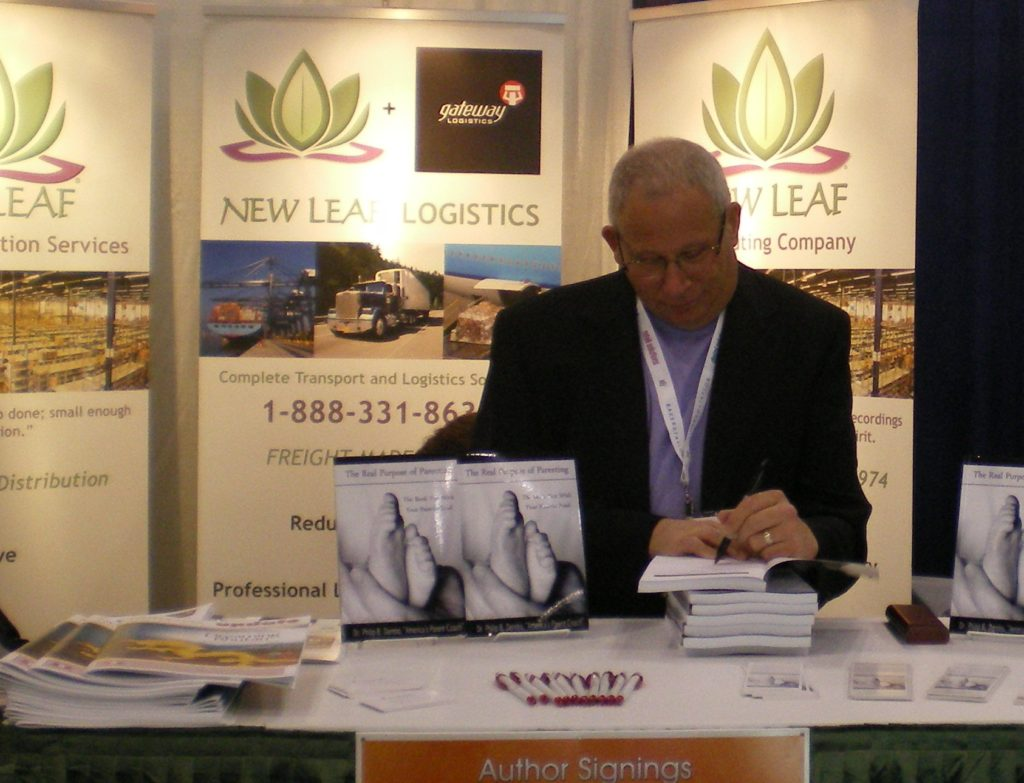 Author, Phil Dembo signing at Book Expo America